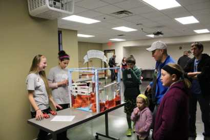 A 6th grade team competes in the Rube Goldberg Competition.