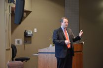 Professor Lars Smith guides the audience through the general benefits and disadvantages of patents. Photo by Rachel Knue.