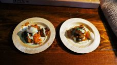 Poached Quail eggs sit atop sweet potatoes and sausage, topped with a creme sauce.