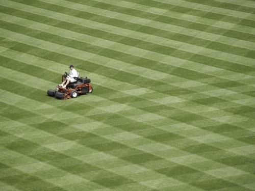 Workman readies a baseball field for the season. Turk Kings