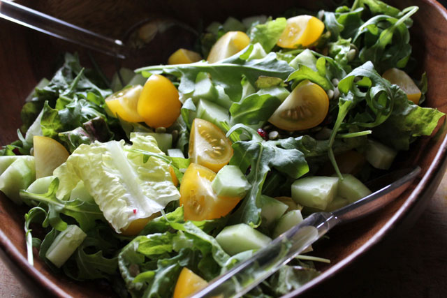 salad-with-arugula-yellow-tomatoes-cucumber-cranberries-pumpkin-seeds