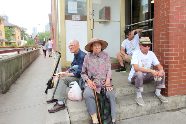 sitting-away-from-the-crowd-chinatown-street-festival-toronto