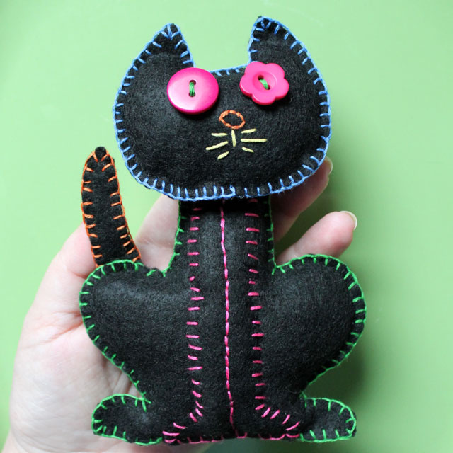embroidered-felt-cat-decoration-with-hand-for-scale