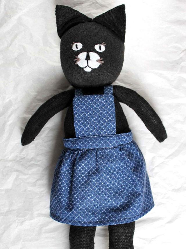handmade-sock-doll-wearing-bibbed-skirt