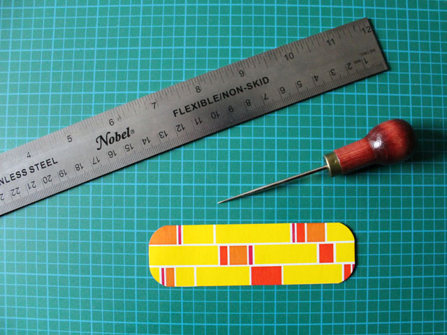 use-an-awl-or-tack-to-punch-holes-before-sewing-on-cardboard-diy-bookmark-handmade