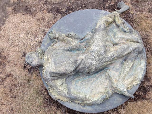 woman-on-ground-sculpture-in-ireland-park-toronto-by-rowan-gillespie