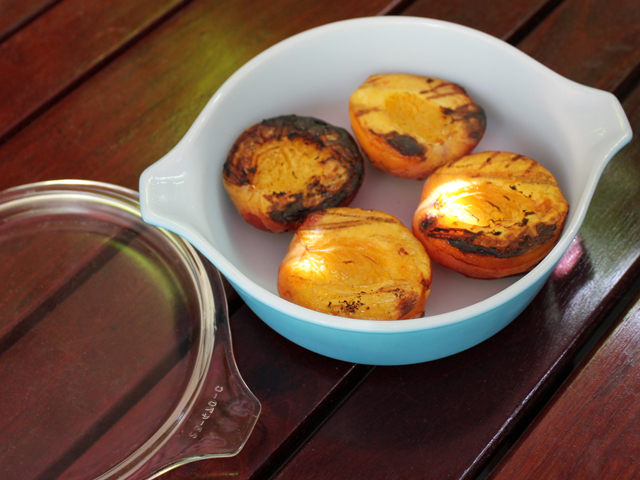 grilled-peaches-cool-in-covered-dish-after-cooking-to-release-juices