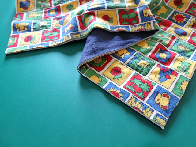 making-quilted-baby-blanket-edges-trimmed-after-quilting