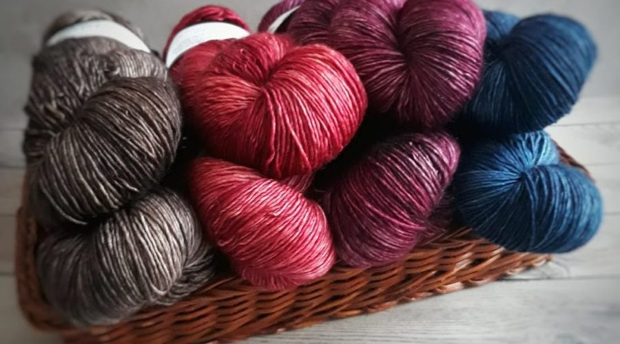 Yarn skeins in blue red silver in basket