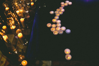 candles float in water pond at night