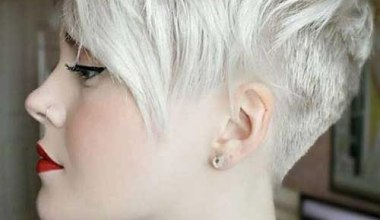 Pixie cut with long bangs and gray hair color
