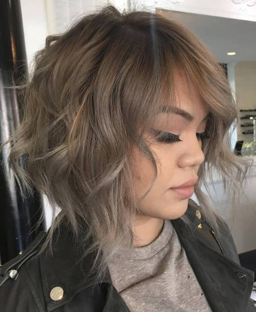 Snazzy messy taupe & silver-gray bob with disconnected layers