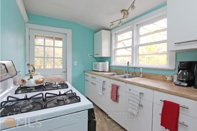 We recently renovated our galley kitchen for under $3000! Here's the before.