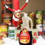 Elf on the Shelf Ideas – Drinking Syrup in Pantry