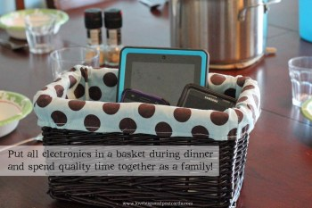 Basket for phones on table during dinner