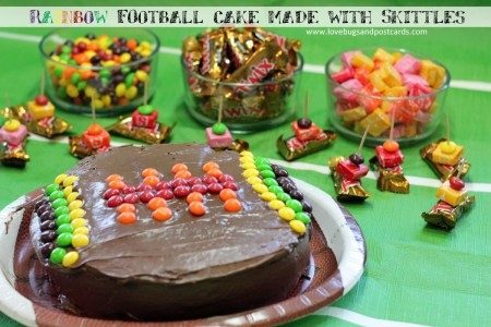 Rainbow football cake made with Skittles for Super Bowl fun #MakeSB50Sweeter