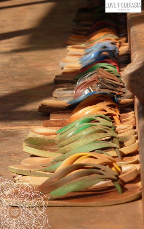 Shoes in front of a school