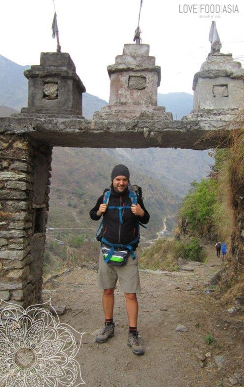 Me under a stone gate