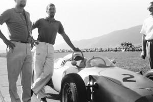 Joakim Bonnier next to a Porsche 804