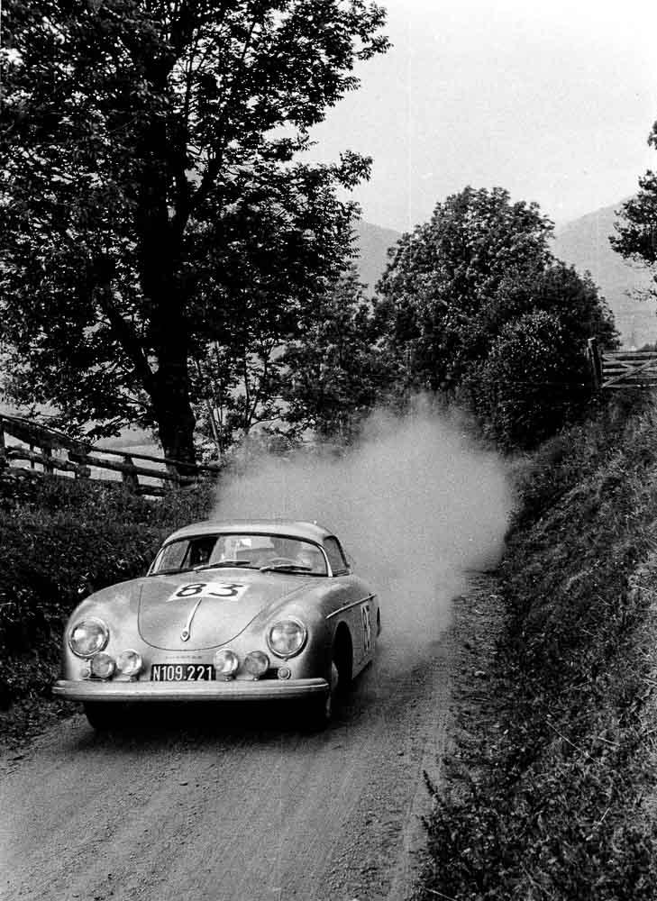 """""""Internationale Alpenabfahrt"""" (International Downhill of the Alps), Austria, 1958: Porsche race driver Ernst Kraus drives the Porsche Type 356 A 1500 GS Carrera Speedster."""