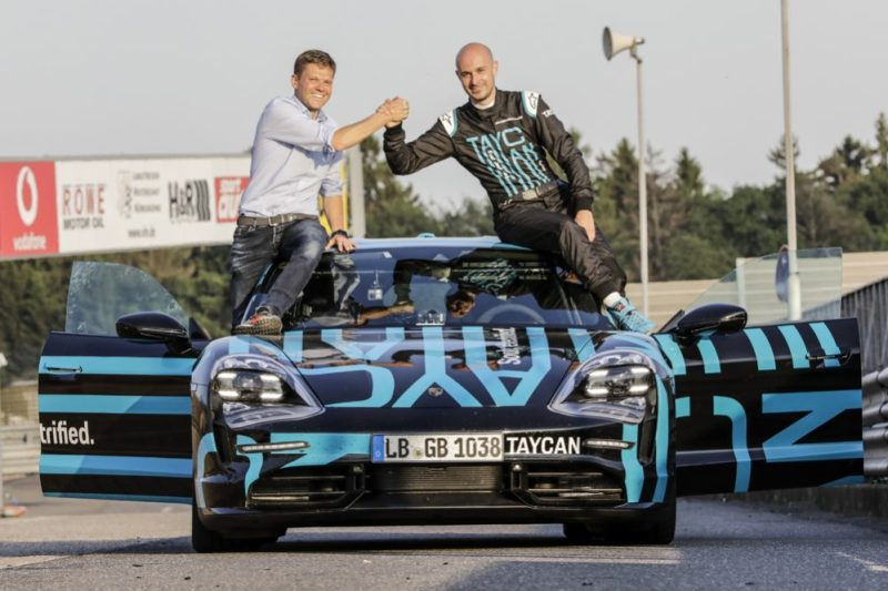 Stefan Weckbach, Vice President Product Line Taycan, and Porsche test driver Lars Kern (l-r) after the record lap on the Nürburgring-Nordschleife.
