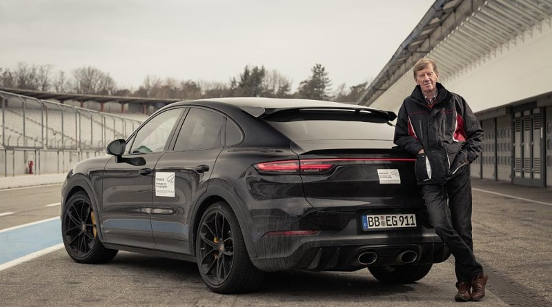 Walter Röhrl with the still slightly camouflaged prototype of a new Cayenne model in Hockenheim.