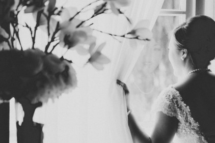 reflection of bride on the window (black and white)