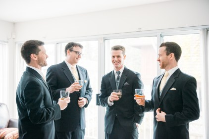 Groomsmen and groom having a great time
