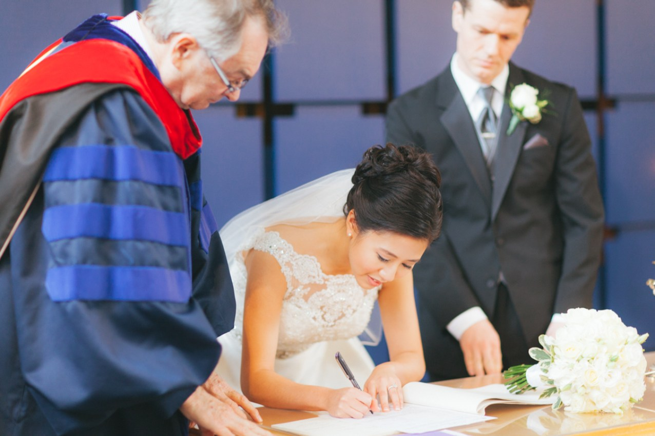 Bride signing the papers (Shaughnessy United Church)
