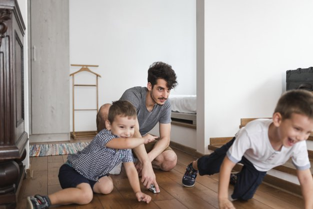 man playing with children
