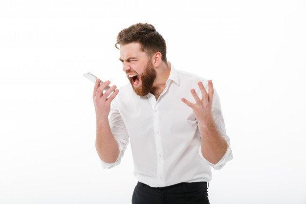 man yeling at phone