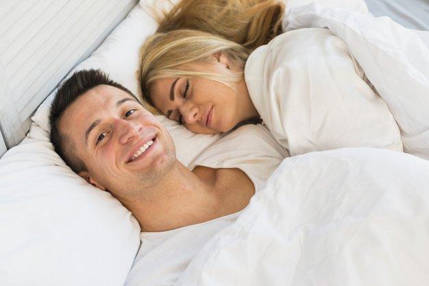 man woman sleeping together