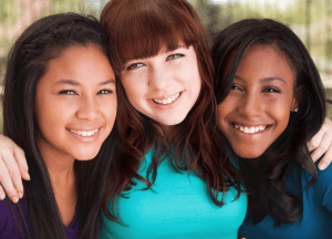 Three teen girls pose together as they smile at the camera. Contact a therapist for teens in sacramento, ca for support. Online therapy for teens from a sacramento therapist can provide the support your teen deserves!