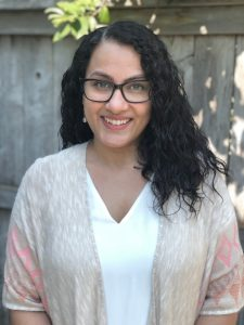 Navneet smiles at the camera. She is a sacramento therapist. Contact an online therapist in california for support with online therapy and other services!
