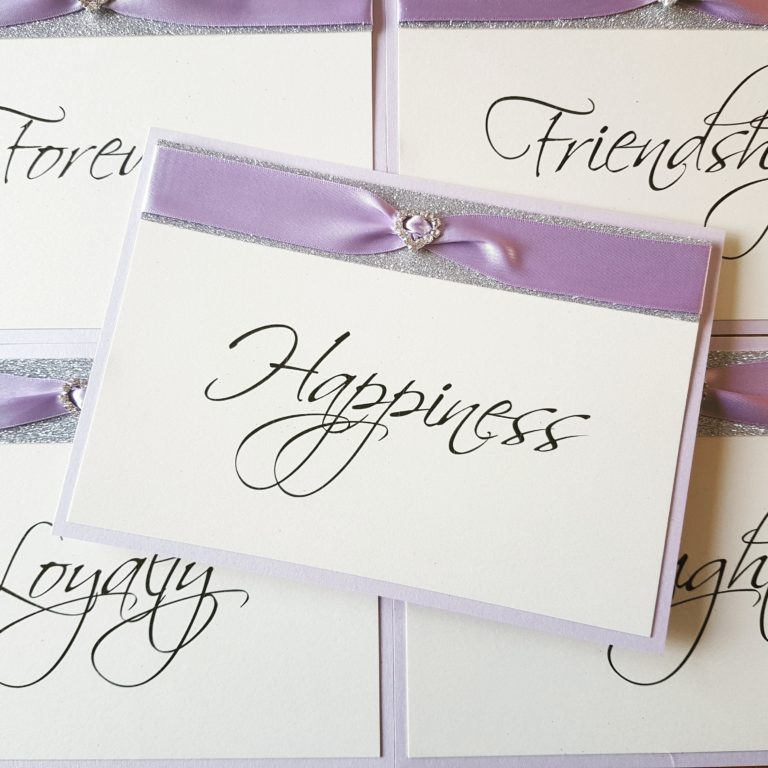 Lilac-and-Silver-Glitter-themed-Table-Name-signs-with-a-fancy-diamante-embellishment-768x768