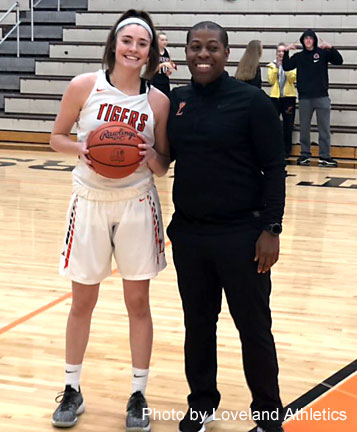 The basketball used for this impressive accomplishment was then given to Kate and the game was stopped for a couple of minutes to give Kate the opportunity to take a picture with her Head Coach, Darnell Parker