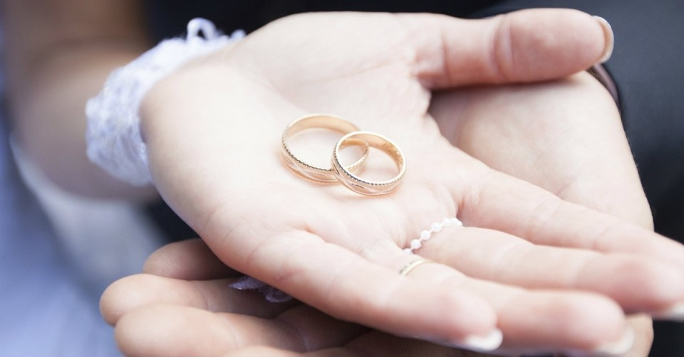 13422-hands-wedding-rings-marriage-couple-wide.1200w.tn