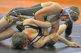 Rocky Mountain senior Brian Crawford works to turn a Powell opponent before pinning him in the semifinals of the Powell Invitational Saturday. David Peck photo