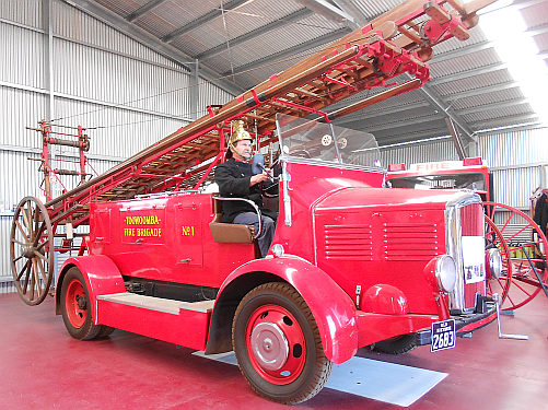 President of the Toowoomba Fire Brigade Historical Society, Lester Naumann, at the wheel of a restored fire engine