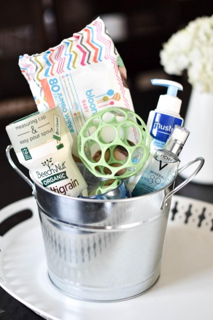 baby sprinkle gift idea: bucket of baby essentials