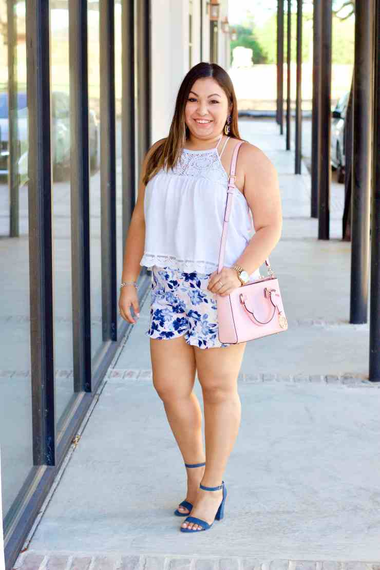pink and blue shorts, white top, pink purse,