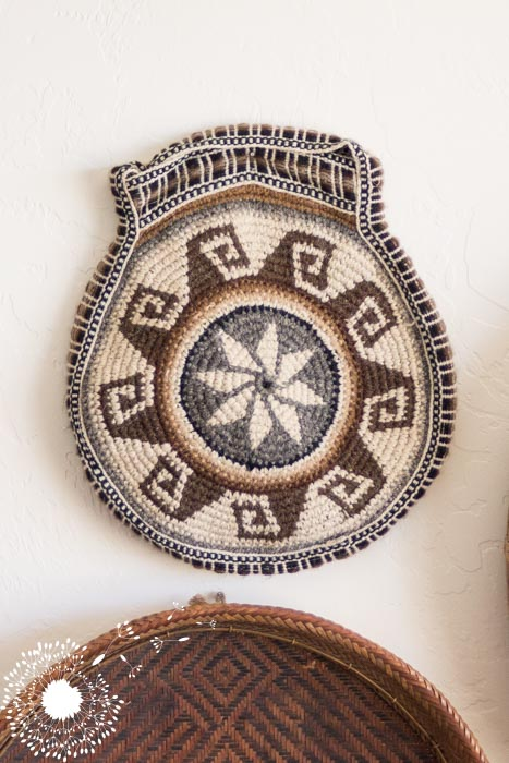 Baskets are an inexpensive way to create a gallery wall {www.lovelyweeds.com}