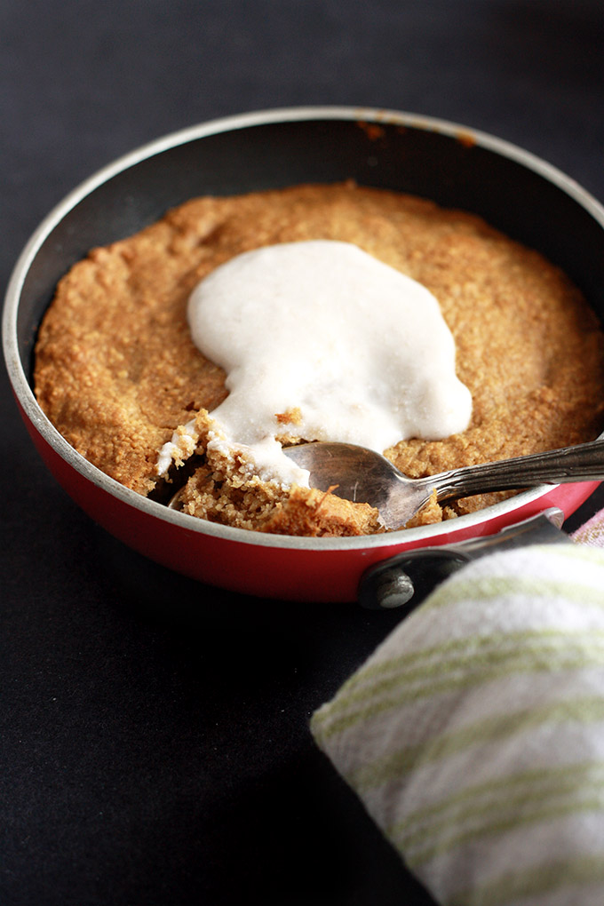 Vegan Tahini Skillet Cookie for One topped with a banana coconut cream - Crispy golden edges, soft chewy middle, nutritious ingredients, and it's easy to whip up! | love me, feed me