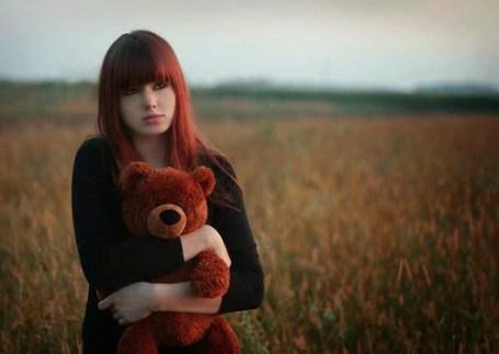 teddy hugging red head profile dp