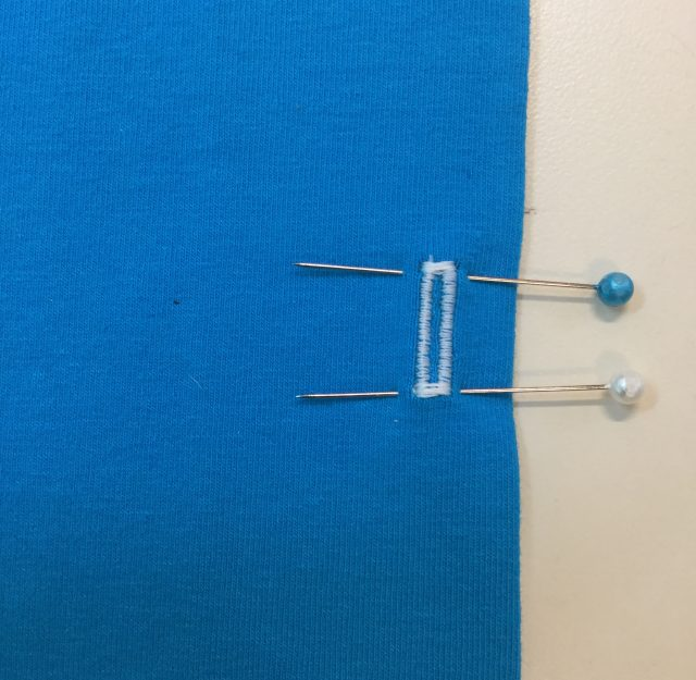 Place pins to protect the buttonhole