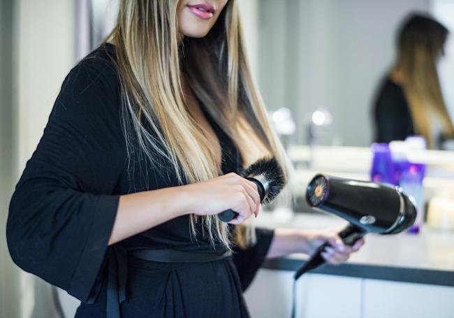 olia-blow-drying-hair-aussie