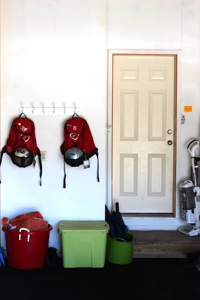 Garage organization project, adding hooks in garage to get things off the ground, garage entry