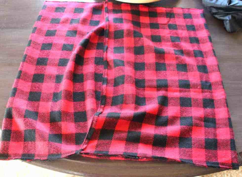 Sew the edges together on both sides of the pillow cover