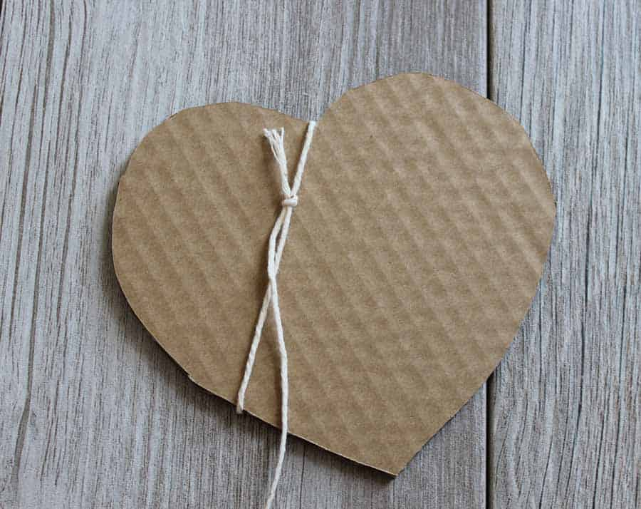 Wrap String around cardboard cut out