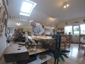 Thomas the Woodcarver preparing our 'mountain climb' lovespoon.